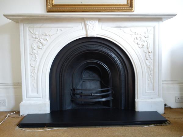 Carved-statuary spandrel mantelpiece